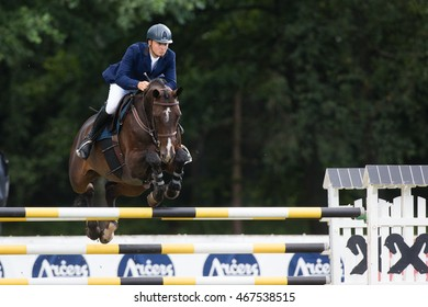 RIGA, LATVIA - JULY 31: Dawid KUBIAK (POL) jumps over the obstacle with horse BAGAZZA M, World Cup competition, Grand Prix Riga 2016, CSI2*-W, CSIYH1* on JULY 31, 2016 in Kleisti sports center