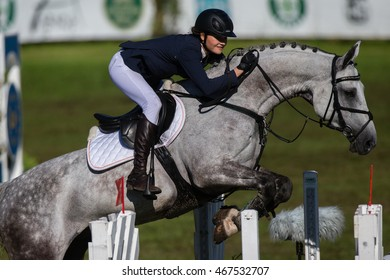 RIGA, LATVIA - JULY 31: Monika VALUNTAITE jumps over the obstacle with horse CELIC, World Cup competition, Grand Prix Riga 2016, CSI2*-W, CSIYH1* on JULY 31, 2016 in Kleisti equestrian sports center