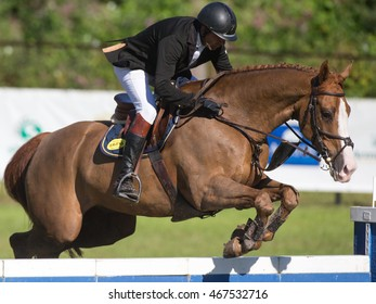 RIGA, LATVIA - JULY 31: Rein PILL (EST) jumps over the obstacle with horse A BROK, World Cup competition, Grand Prix Riga 2016, CSI2*-W, CSIYH1* on JULY 31, 2016 in Kleisti equestrian sports center