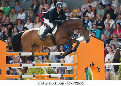 RIGA, LATVIA - JULY 31: Urmas RAAG jumps over the obstacle with horse IBELLE VAN DE GROTE HAART, World Cup competition, Grand Prix Riga 2016, CSI2*-W, CSIYH1* on JULY 31, 2016 in Kleisti sports center