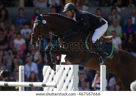 RIGA, LATVIA - JULY 31: Urmas RAAG (EST) jumps over the obstacle with horse CARLOS, World Cup competition, Grand Prix Riga 2016, CSI2*-W, CSIYH1* on JULY 31, 2016 in Kleisti equestrian sports center