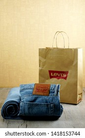 RIGA, LATVIA - june 01, 2019: Levi's Denim blue Jeans with red Company Logo on Shopping Bag