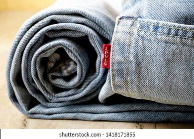 RIGA, LATVIA - June 01, 2019 Closeup of Levi's pocket and tag label of logo sewed on a blue jeans. LEVI'S is a brand name of Levi Strauss and Co, founded in 1853
