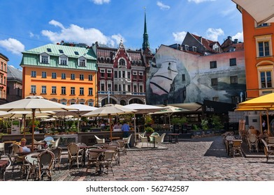 RIGA, LATVIA - JUNE 10, 2016: Cozy street cafe surrounded by historic buildings in the center of old town - Dome Square