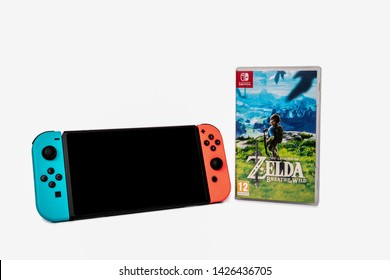 Riga, Latvia -  June 17, 2019: Nintendo Switch, the video game console for home or portable gaming. Game The Legend of Zelda. White background