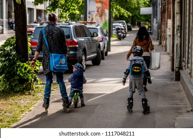 Riga, Latvia June 18,2018 Family with kids pending time together, kids on rollerblades, city life style