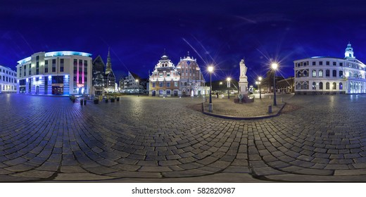 RIGA, LATVIA - June 2013: Full 360 degrees panorama in equirectangular equidistant spherical projection of Town Hall Square at night. VR content