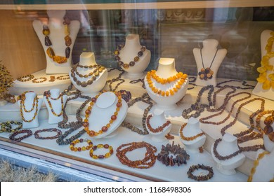 RIGA, LATVIA - June, 2018: cityscape. walking medieval streets of the old city of Riga, Latvia. view of designers amber jewels shop-window of jeweller's store in historical center.