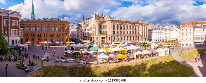 "RIGA, LATVIA, June 21, 2018: The Latvian Radio building in Riga Dome Cathedral Square, historic Old town (Vecriga), Riga, Latvia, Europe with Midsummer celebration market for ""Jani"" summer festival."