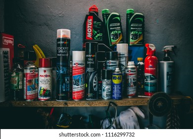 Riga, Latvia June 4, 2018 Different car lubricant and engine treatment products on shelf in garage