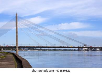 RIGA, LATVIA - JUNE 7, 2016: Vansu Bridge (1981, former Gorky Bridge) over Daugava River in Riga, Latvia. One of five big bridges in Riga and the only cable-stayed