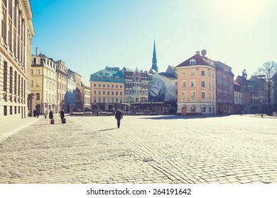 Riga, Latvia - March 19, 2015: Tourists are walking on Doma square
