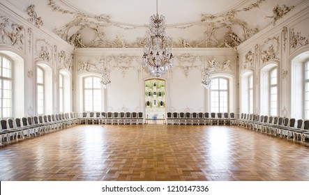 Riga, Latvia- March 2, 2012: Inside of baroque styled Throne room Great Hall Ballroom in Rundale Palace. Spacious hall with parquet floors bas relief on walls windows, lot od chairs in a row, nobody