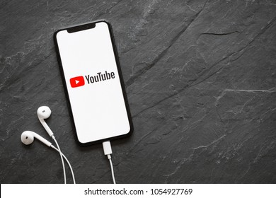 Riga, Latvia - March 25, 2018: Latest generation iPhone X with YouTube logo on the screen.