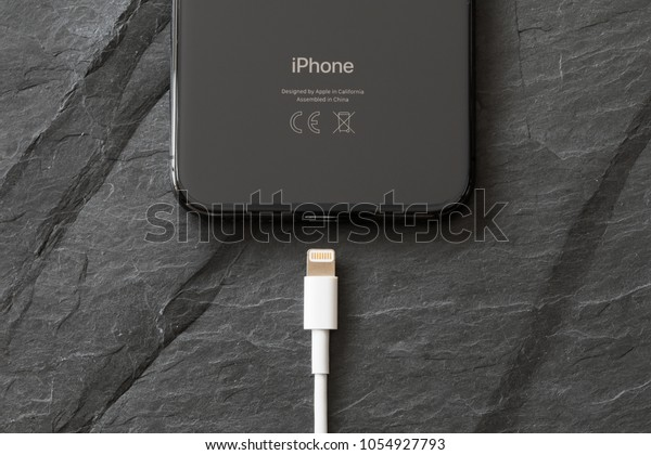 Riga, Latvia - March 25, 2018: Latest generation iPhone X with charger connector.
