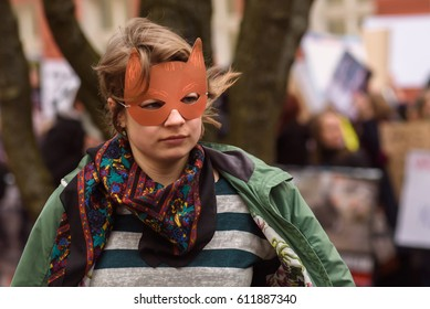 RIGA, LATVIA - March 30, 2017. Young woman, wearing animal mask attends protest against wildlife animal using at Circus, near Parliament of Latvia, in Riga , Latvia.