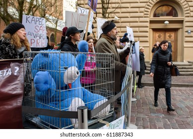 RIGA, LATVIA - March 30, 2017. Big blue plush bear in cage in front of the Parliament of Latvia. Protest against wildlife animal using at Circus, near Parliament of Latvia, in Riga , Latvia.