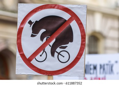 """RIGA, LATVIA - March 30, 2017. Sign """"NO bear on bicycle"""". Protest event against wildlife animal using at Circus, near Parliament of Latvia, in Riga , Latvia."""