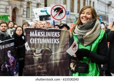 RIGA, LATVIA - March 30, 2017. Woman at protest against wildlife animal using at Circus, near Parliament of Latvia, in Riga , Latvia.
