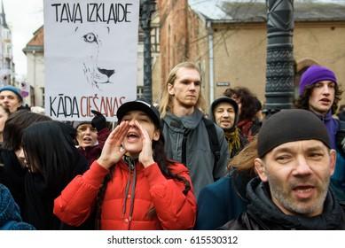 RIGA, LATVIA - March 30, 2017. Woman screaming at protest against wildlife animal using at Circus, near Parliament of Latvia, in Riga , Latvia.