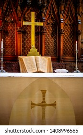 Riga, Latvia - May 18, 2018. Riga Luther Church. Church altar with cross and bible before wedding ceremony. Open bible on altar before worship. Interior of church.