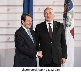 RIGA, LATVIA - May 21, 2015: Eastern Partnership Sammit. President of Latvia Andris Berzins welcomes President of the Republic of Cyprus Nikos Anastasiadis