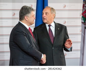 RIGA, LATVIA - May 21, 2015: Eastern Partnership Sammit. President of Latvia Andris Berzins welcomes President of Ukraine Petro Poroshenko.