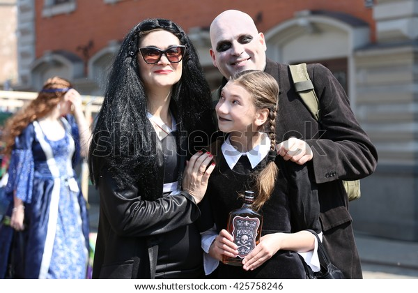 """RIGA, LATVIA - MAY 21, 2016: Participants of the public open masquerade festival """"May Earl"""" represent Addams Family costumes shown on May 21, 2016 in Riga, Latvia. The festival is held annually"""