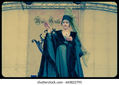 """RIGA, LATVIA - MAY 21, 2017: Participant of the public open masquerade festival """"May Earl"""" represents Middle ages costume shown on May 21, 2017 in Riga, Latvia.  Instagram retro effects"""