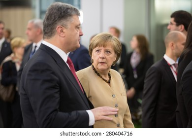 RIGA, LATVIA - May 22, 2015: Eastern Partnership Sammit. President of Ukraine Petro Poroshenko speaks with Chancellor of the Federal Republic of Germany Angela Merkel