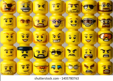 Riga, Latvia - May 22, 2019: Different LEGO minifigure heads stacked side-by-side and one on top of each other. This shows the evolution of LEGO minifigure head prints through the years.