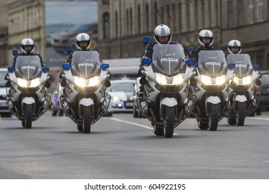 Riga Latvia - May 25, 2013 ; A group of Latvian Police motorcyclists escorting transport in Riga