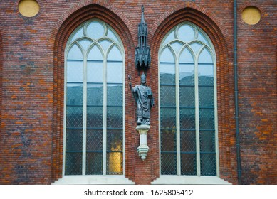 RIGA, LATVIA - NOVEMBER 03, 2013: View of the sculpture of the founder of Riga, Bishop Albert fon Buksgevden on the wall of the Dome Cathedral