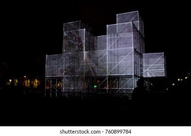 RIGA, LATVIA - NOVEMBER 18, 2012: StaroRiga festival. Beaming Riga celebrating 99th anniversary of independence. Light object. PIXEL CLOUD Esplanade