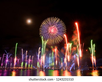 Riga, Latvia - November 18, 2018. Multi-colored fireworks exhibition Saules Muzs (The Life of the Sun) during programme of the the 100th anniversary of the Proclamation of the Republic of Latvia - Shutterstock ID 1243231510