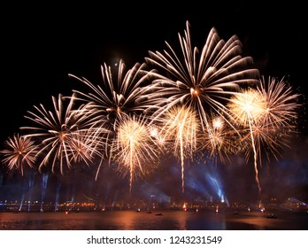 Riga, Latvia - November 18, 2018. Multi-colored fireworks exhibition Saules Muzs (The Life of the Sun) during programme of the the 100th anniversary of the Proclamation of the Republic of Latvia - Shutterstock ID 1243231549