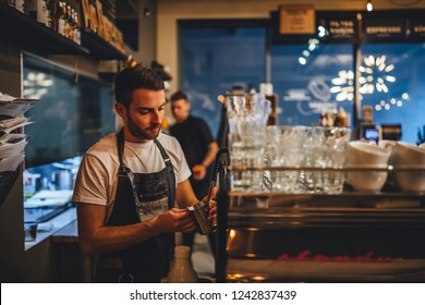 Riga, Latvia november 23, 2018 Barista making coffee in coffee shop