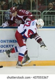 RIGA, LATVIA - NOVEMBER 26: Emil Galimov (72) checks Gunars Skvorcovs (13) in to the boards in KHL game between Dinamo Riga and Lokomotiv Yaroslavl played on NOVEMBER 26, 2015 in Arena Riga