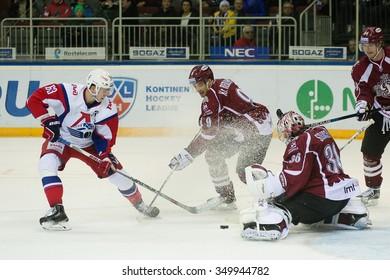 RIGA, LATVIA - NOVEMBER 26: Pavel Kraskovsky (63) tries to score the goal in KHL game between Dinamo Riga and Lokomotiv Yaroslavl played on NOVEMBER 26, 2015 in Arena Riga