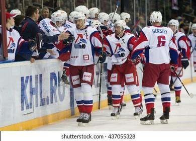 RIGA, LATVIA - NOVEMBER 26: Players of Lokomotiv Yaroslavl celebrate the goal of Staffan Kronwall (27) in KHL game against Dinamo Riga played on NOVEMBER 26, 2015 in Arena Riga
