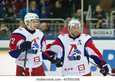 RIGA, LATVIA - NOVEMBER 26: Players Jiri Novotny (12) and Ilya Gorokhov (77) celebrate the goal in KHL game between Dinamo Riga and Lokomotiv Yaroslavl played on NOVEMBER 26, 2015 in Arena Riga