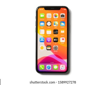 Riga, Latvia - November 28, 2019: Apple iPhone 11 Pro with icons of home screen, isolated on white background.