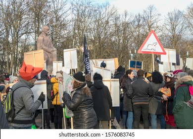 Riga, Latvia - November 30, 2019 : Crowd of activists at Animal Advocacy event with NO FUR signs and banners in hands protest against fur farming, ask to ban animal fur use for fashion industry