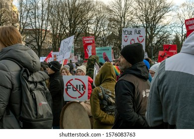 Riga, Latvia - November 30, 2019 : People at Animal Advocacy event with NO FUR signs and banners in hands protest against fur farming, ask to ban animal fur industry and change legislation and policy