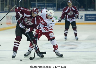 RIGA, LATVIA - OCTOBER 1: Gints Meija (87) and Vyacheslav Leshchenko (27) fight for the puck in KHL game between Dinamo Riga and Spartak played on OCTOBER 1, 2015 in Arena Riga