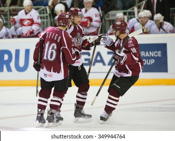 RIGA, LATVIA - OCTOBER 1: Players of Dinamo Riga celebrate the goal in KHL game between Dinamo Riga and Spartak played on OCTOBER 1, 2015 in Arena Riga