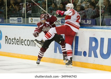 RIGA, LATVIA - OCTOBER 1: Tim Sestito (43) collides into the boards with player of Spartak in KHL game between Dinamo Riga and Spartak played on OCTOBER 1, 2015 in Arena Riga
