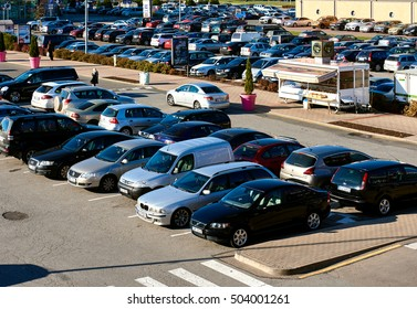 """Riga, Latvia - October 17, 2016: Cars parked in a parking lot at shopping sentre """"Spice"""" in Riga city. Northern Europe. Latvia"""