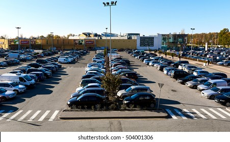 "Riga, Latvia - October 17, 2016: Cars parked in a parking lot at shopping sentre ""Spice"" in Riga city. Northern Europe. Latvia"