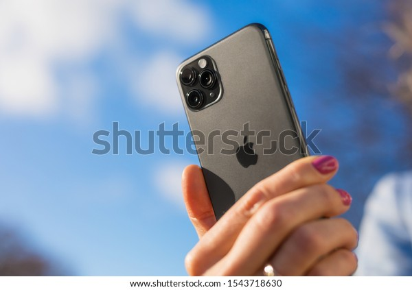 Riga, Latvia - October 28, 2019: Person is holding in hand latest Apple iPhone 11 Pro smartphone.